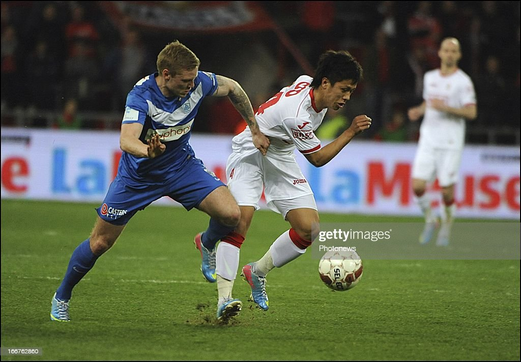 LIEGE BELGIUM APRIL Yuji Ono of Standard and Brian Hamalainen of KRC Genk pictured during the Jupiler League Playoff match between Standard Liege and...