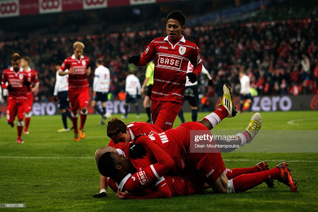 Yuji Ono of Standard celebrates after a team mate scores a goal during the Jupiler League match between Standard de Liege and KV Kortrijk at Stade...