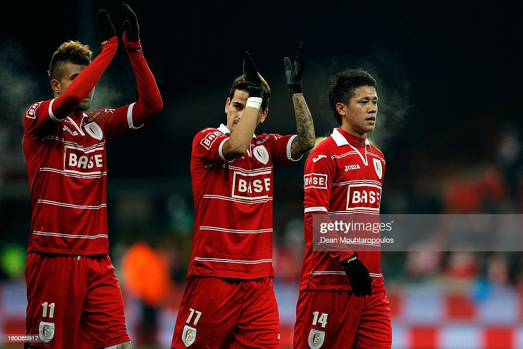 Yuji Ono of Standard celebrates with team mates after victory in the Jupiler League match between Standard de Liege and KV Kortrijk at Stade Maurice...