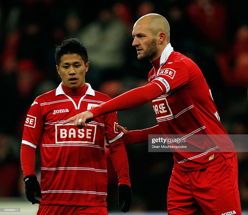 Yuji Ono of Standard gets advice from his captain Jelle Van Damme during the Jupiler League match between Standard de Liege and KV Kortrijk at Stade...