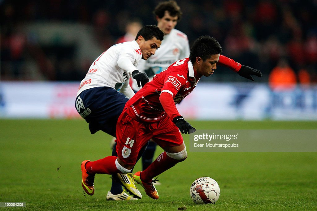 Yuji Ono of Standard is tackled and fouled by Mustapha Oussalah of Kortrijk during the Jupiler League match between Standard de Liege and KV Kortrijk...