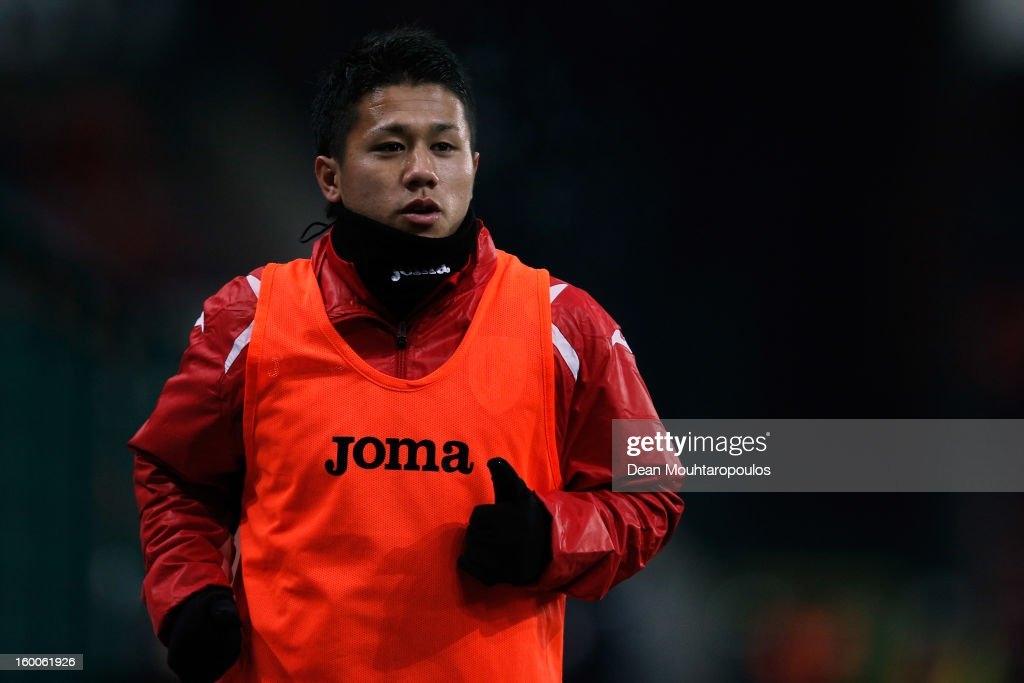 Yuji Ono of Standard warms up during the Jupiler League match between Standard de Liege and KV Kortrijk at Stade Maurice Dufrasne the on January 25...