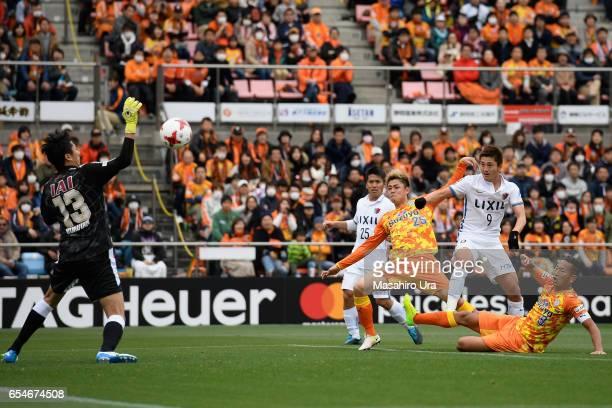 Yuji Rokutan of Shimizu SPulse saves a shot by Yuma Suzuki of Kashima Antlers during the JLeague J1 match between Shimizu SPulse and Kashima Antlers...