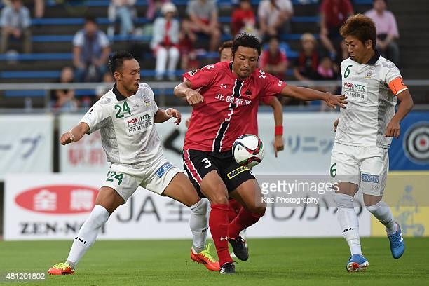 Yuji Sakuda of Zweigen Kanazawa keeps the ball under the pressure from Hiroaki Namba and Keiji Takachi of FC Gifu during the JLeague second division...
