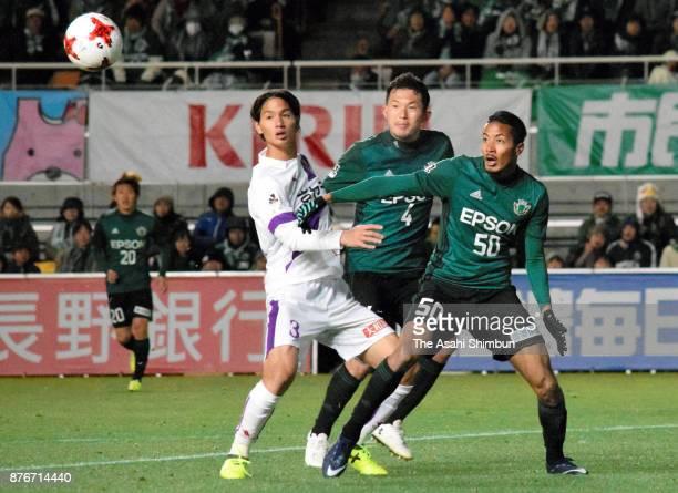 Yuji Takahashi of Kyoto Sanga competes for the ball against Masaki Iida and Musashi Suzuki of Matsumoto Yamaga during the JLeague J2 match between...
