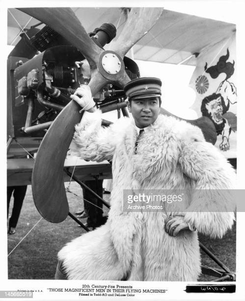 Yujiro Ishihara standing next to propeller in a scene from the film 'Those Magnificent Men In Their Flying Machines Or How I Flew From London To...