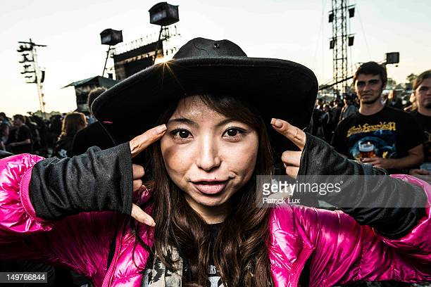 Yuka from Japan who works in the healthcare business by day attends the Wacken Open Air heavy metal music fest on August 3 2012 in Wacken Germany...