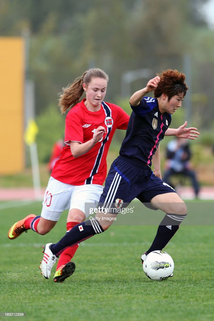 Yuka Kado DF of Japan challenges Caroline Graham Hansen FW of Norway during the Algarve Cup match between Japan and Norway at the Complexo Desportivo Belavista on March 6, 2013 in Parchal, Portugal.