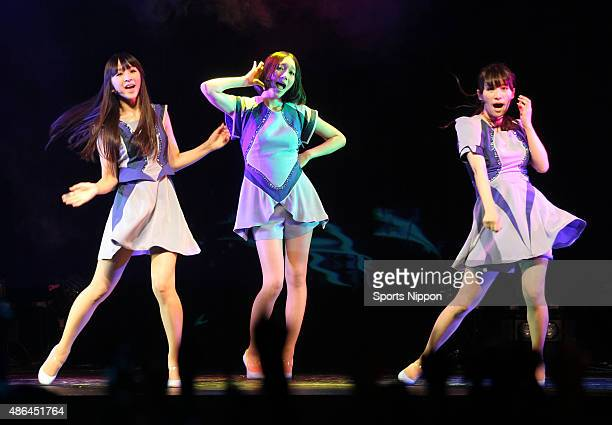 Yuka Kashino Ayano Omoto and Ayaka Nishiwaki of pop group Perfume perform during the Kirin press conference on July 23 2012 in Tokyo Japan