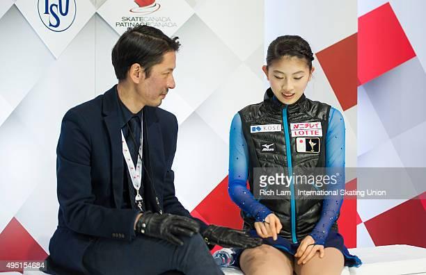 Yuka Nagai of Japan and her coach Megumu Seki celebrate after the Ladies Free Skate on day two of Skate Canada International ISU Grand Prix of Figure...