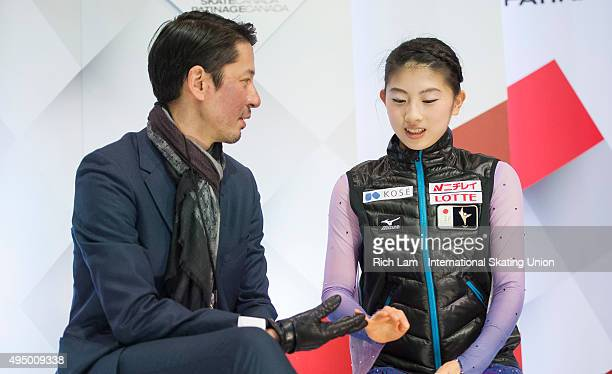 Yuka Nagai of Japan and her coach Megumu Seki celebrate her results in the Ladies Short Program on day one of Skate Canada International ISU Grand...