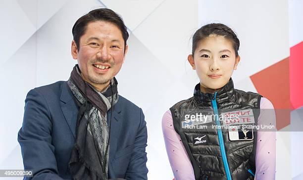Yuka Nagai of Japan and her coach Megumu Seki wait for her results in the Ladies Short Program on day one of Skate Canada International ISU Grand...