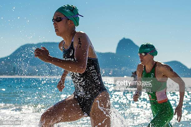Yuka Sato of Japan and Aileen Reid of Ireland leave the water during the women's triathlon ITU World Olympic Qualification Event at Copacabana beach...