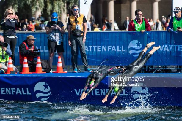 Yuka Sato of Japan and Ashleigh Gentle of Australia compete during the women's elit race of the Vattenfall World Triathlon Stockholm on August 26...