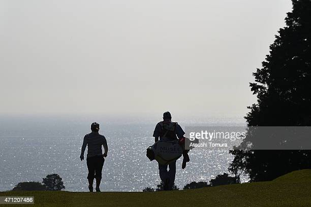 Yukari Baba of Japan and her caddie walk on the fair way on the 5th hole during the third round of Fujisankei Ladies Classic at the Kawana Hotel Golf...