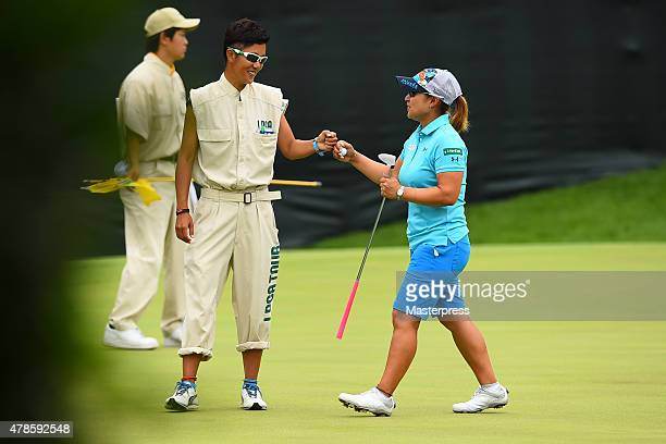 Yukari Baba of JAPAN smiles after making her birdie putt on the 1st hole during the second round of the Earth Mondamin Cup at the Camellia Hills...
