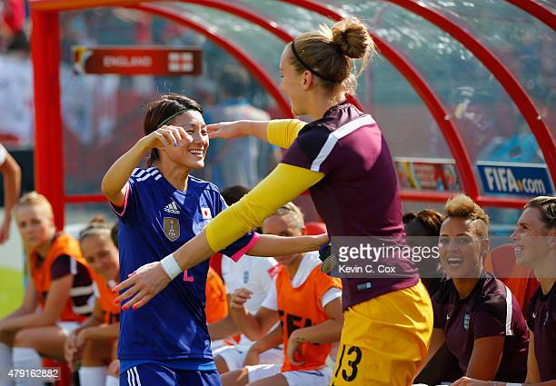 Yukari Kinga of Japan speaks to Siobhan Chamberlain of England before the FIFA Women's World Cup Semi Final match between Japan and England at the...
