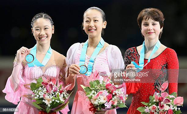 Yukari Nakano of Japan Mao Asada of Japan and Irina Slutskaya of Russia pose with their medals after competing in the Ladies' Free Skating event of...