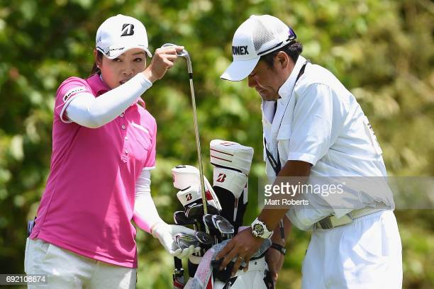 Yukari Nishiyama of Japan speaks with her caddie during the final round of the Yonex Ladies Golf Tournament 2016 at the Yonex Country Club on June 4...