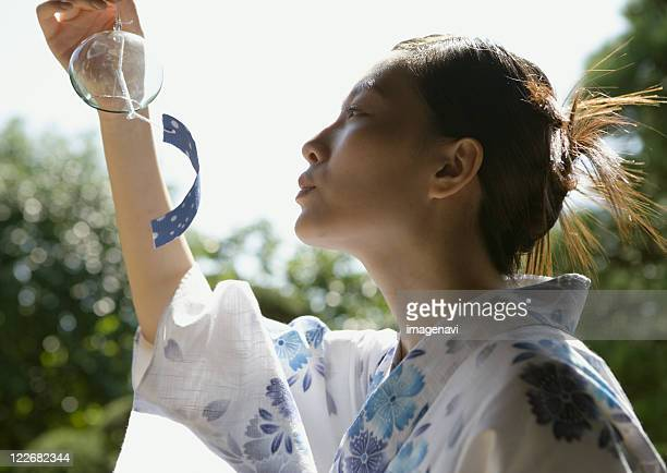 Yukata dressed woman and wind-chime