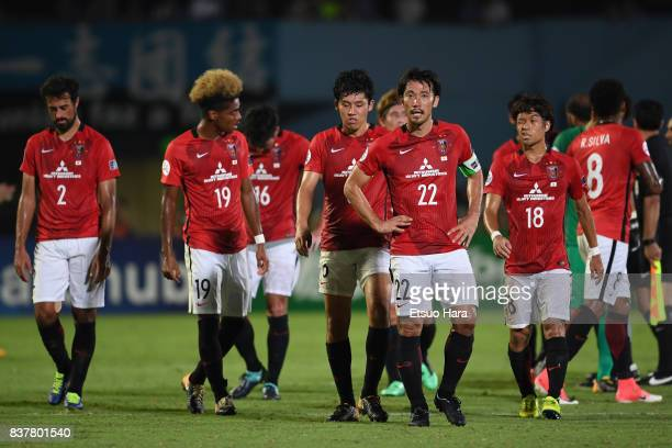 Yuki Abe and Urawa Red Diamonds players show dejection after their 13 defeat in the AFC Champions League quarter final first leg match between...