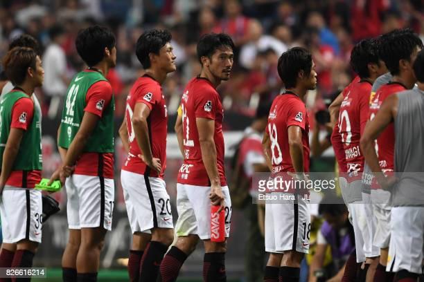Yuki Abe and Urawa Red Diamonds players show dejection after their 22 draw in the JLeague J1 match between Urawa Red Diamonds and Omiya Ardija at...