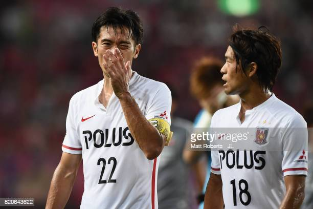 Yuki Abe and Yoshiaki Komai of Urawa Red Diamonds leave the pitch after their 24 defeat in the JLeague J1 match between Cerezo Osaka and Urawa Red...