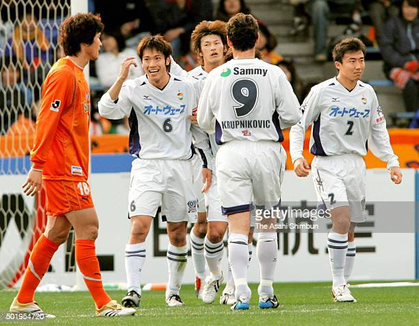 Yuki Abe of JEF United Chiba celebrates scoring his team's first goal with his team mates during the JLeague match between Shimizu SPulse and JEF...