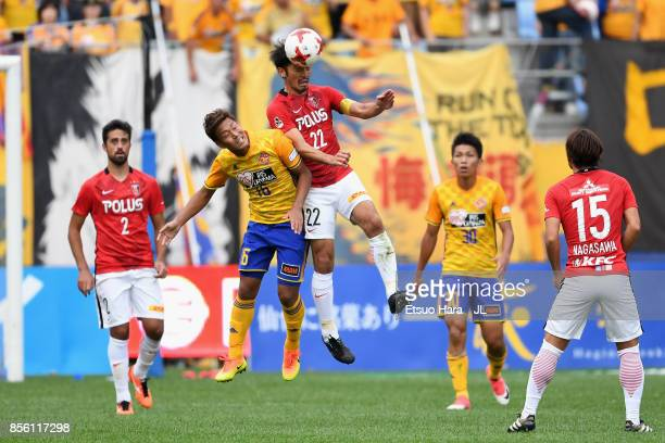 Yuki Abe of Urawa Red Diamonds and Gakuto Notsuda of Vegalta Sendai compete for the ball during the JLeague J1 match between Vegalta Sendai and Urawa...