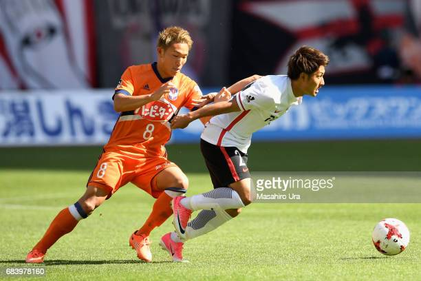 Yuki Abe of Urawa Red Diamonds and Kei Koizumi of Albirex Niigata compete for the ball during the JLeague J1 match between Albirex Niigata and Urawa...