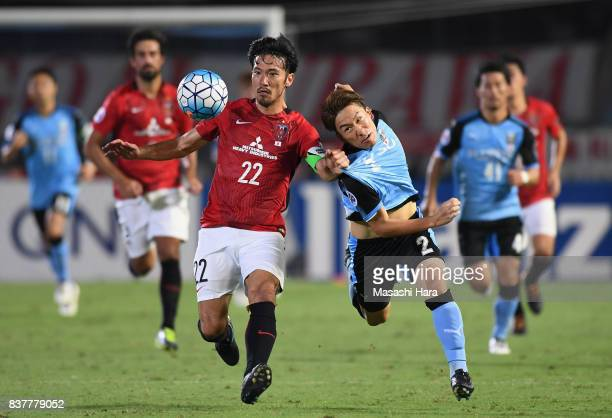 Yuki Abe of Urawa Red Diamonds and Kyohei Noborizato of Kawasaki Frontale compete for the ball during the AFC Champions League quarter final first...