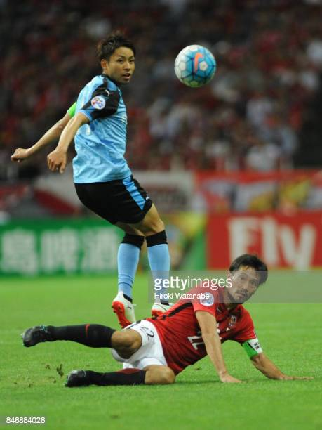 Yuki Abe of Urawa Red Diamonds and Yu Kobayashi of Kawasaki Frontale compete for the ball during the AFC Champions League quarter final second leg...