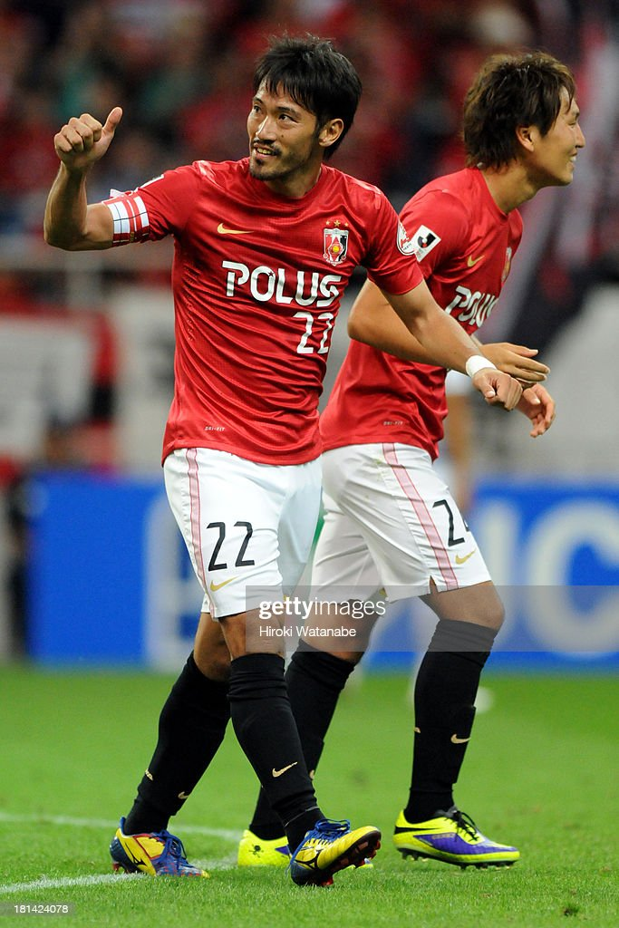 <a gi-track='captionPersonalityLinkClicked' href=/galleries/search?phrase=Yuki+Abe&family=editorial&specificpeople=643492 ng-click='$event.stopPropagation()'>Yuki Abe</a> (L) of Urawa Red Diamonds celebrates scoring his team's first goal from the penalty spot during the J.League match between Urawa Red Diamonds and Ventforet Kofu at Saitama Stadium on September 21, 2013 in Saitama, Japan.
