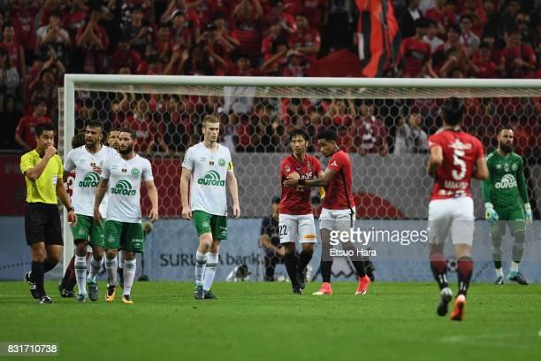 Yuki Abe of Urawa Red Diamonds celebrates scoring the opening goal with his team mate Rafael Silva during the Suruga Bank Championship match between...