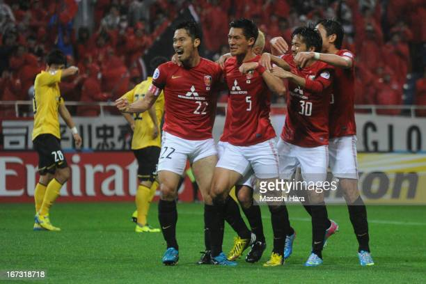 Yuki Abe of Urawa Red Diamonds celebrates the second goal during the AFC Champions League Group F match between Urawa Red Diamonds and Guangzhou...