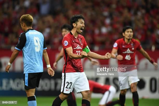 Yuki Abe of Urawa Red Diamonds celebrates the win during the AFC Champions League quarter final second leg match between Urawa Red Diamonds and...