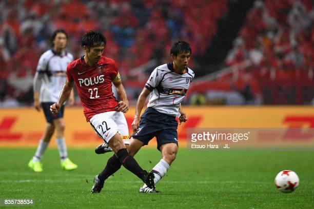 Yuki Abe of Urawa Red Diamonds controls the ball under pressure of Sei Muroya of FC Tokyo during the JLeague J1 match between Urawa Red Diamonds and...