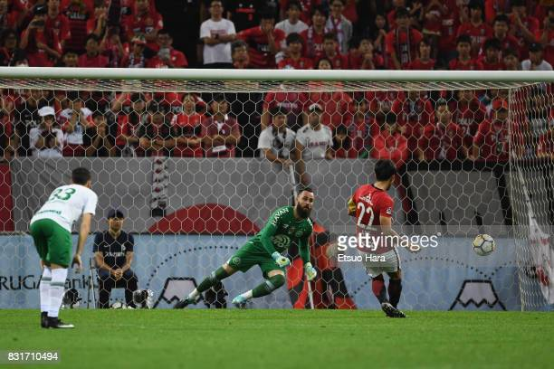 Yuki Abe of Urawa Red Diamonds converts the penalty to score the opening goal during the Suruga Bank Championship match between Urawa Red Diamonds...