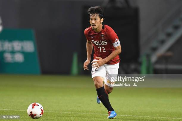 Yuki Abe of Urawa Red Diamonds in action during the JLeague J1 match between Sagan Tosu and Urawa Red Diamonds at Best Amenity Stadium on June 25...