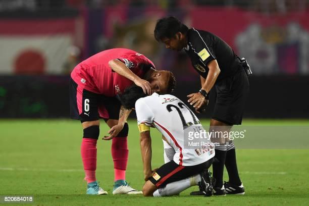 Yuki Abe of Urawa Red Diamonds is talked by Souza of Cerezo Osaka during the JLeague J1 match between Cerezo Osaka and Urawa Red Diamonds at Yanmar...