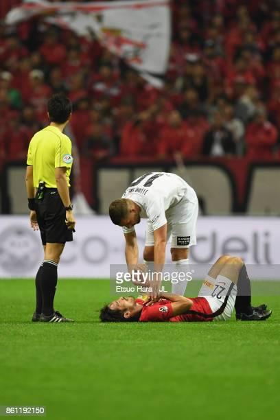 Yuki Abe of Urawa Red Diamonds lies injured during the JLeague J1 match between Urawa Red Diamonds and Vissel Kobe at Saitama Stadium on October 14...