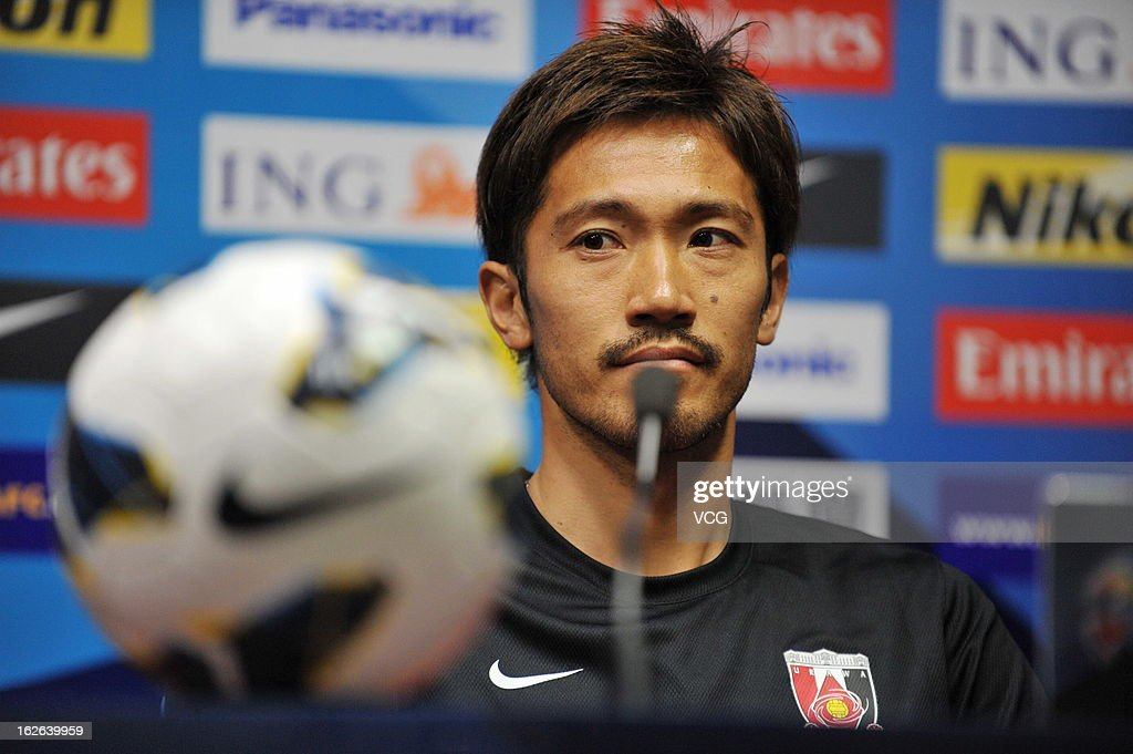 <a gi-track='captionPersonalityLinkClicked' href=/galleries/search?phrase=Yuki+Abe&family=editorial&specificpeople=643492 ng-click='$event.stopPropagation()'>Yuki Abe</a> of Urawa Red Diamonds looks on during a press conference ahead of the AFC Champions League match between Guangzhou Evergrande and Urawa Red Diamonds at Tianhe Sports Center on February 25, 2013 in Guangzhou, China.