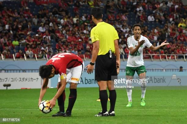 Yuki Abe of Urawa Red Diamonds prepares to take a penalty while Lucas Mineiro of Chapecoense protests over the penalty decision to referee Kim...