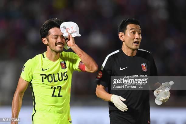 Yuki Abe of Urawa Red Diamonds receives medical treatment during the JLeague J1 match between Ventforet Kofu and Urawa Red Diamonds at Yamanashi Chuo...