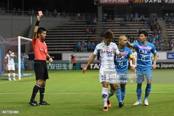 Yuki Hashizume of Ventforet Kofu is shown a red card by referee Yusuke Araki during the JLeague J1 match between Sagan Tosu and Ventforet Kofu at...