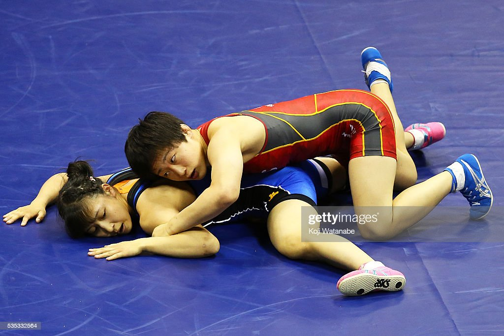 Yuki Irie (red) competes in the Women's 48kg freestyle semi final match against Miyu Nakamura (blue) during the All Japan Wrestling Championships at Yoyogi National Gymnasium on May 29, 2016 in Tokyo, Japan.