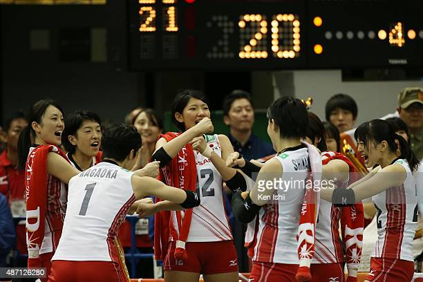 Yuki Ishii of Japan celebrates with her teammate after a point in the match between Japan and China during the FIVB Women's Volleyball World Cup...