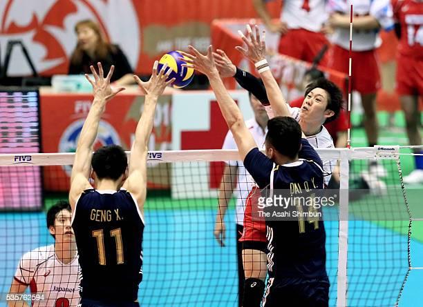 Yuki Ishikawa of Japan is blocked during the Men's World Olympic Qualification Tournament between Japan and China at the Tokyo Metropolitan Gymnasium...