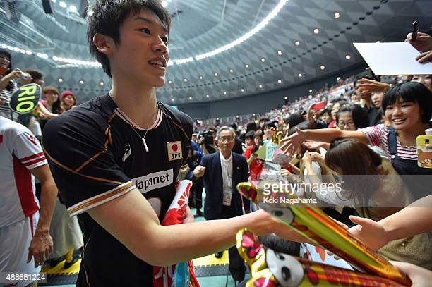 Yuki Ishikawa of Japan shakes hands with fans after winning the match against Tunisia during the FIVB Men's Volleyball World Cup Japan 2015 at the...