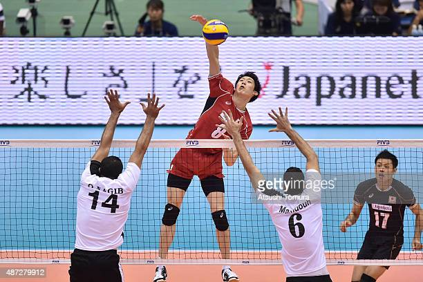 Yuki Ishikawa of Japan spikes in the match between Japan and Egypt during the FIVB Men's Volleyball World Cup Japan 2015 at the Hiroshima Green Arena...